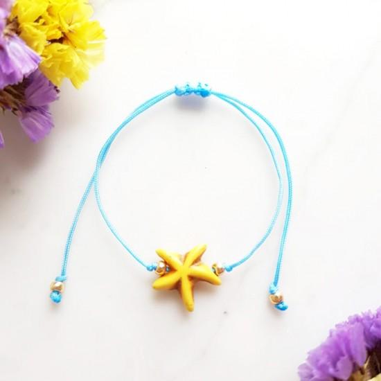 Bransoletka dla dzieci żółta rozgwiazda na niebieskim sznurku