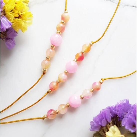 Bransoletka dla dzieci różowe jadeity na żółtym sznurku