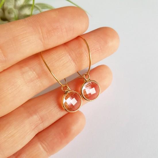 Różowa bransoletka ze szklanych koralików z zawieszką miś